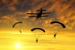 Silhouette skydiver parachutist landing Royalty Free Stock Image