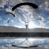Silhouette skydiver parachutist landing Stock Photos