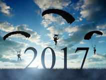 Silhouette skydiver parachutist landing in to the New Year 2017 Royalty Free Stock Photography