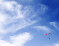 Silhouette of skydiver at sky Stock Image