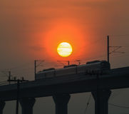 Silhouette skytrain and big sun Royalty Free Stock Photography