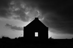 Silhouette of slave hut. A gray tone silhouette of an abandoned slave hut on the Caribbean island of Bonaire at sunset Stock Photography