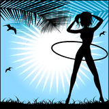 Silhouette of a slender woman doing exercises with hula-hoop Stock Photography
