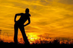 Silhouette of the slim girl stretching out Royalty Free Stock Image