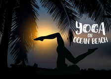 Silhouette slim woman makes yoga exercise on the ocean beach at sunset. Palm trees around. Stock Image