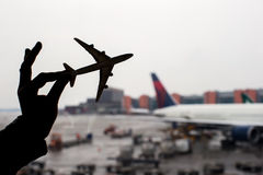 Silhouette of a small airplane model on airport background Royalty Free Stock Images
