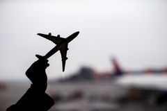 Silhouette of a small airplane model on airport background Stock Photos