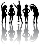 Silhouette of small girls. Engaged in aerobics Stock Image