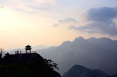 The silhouette of a small pavilion on the peak Stock Photography