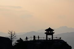The silhouette of a small pavilion on the peak. Dawn, the silhouette of a small pavilion on the peak, in colorful sky stock photos