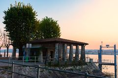 Silhouette small river station on the island against the evening sky. royalty free stock photos