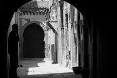 Silhouette in a small typical street of Essaouira Stock Images