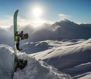 Silhouette of snowboard standing upright in snow Stock Image