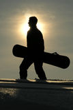 Silhouette of a snowboarder. Silhouette of man with snowboard royalty free stock photos