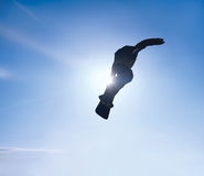 Silhouette the snowboarder in the blue sky Stock Images
