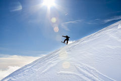 Silhouette of a Snowboarder jumping. Royalty Free Stock Image