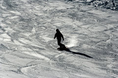 Silhouette of snowboarder Stock Photo