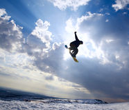 Silhouette the snowboarder in the sky Royalty Free Stock Photo