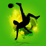 Silhouette soccer player overhead kick. With a splatter background Royalty Free Stock Images