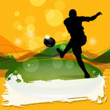 Silhouette Soccer Player Shooting. With colorful abstract background Stock Photography