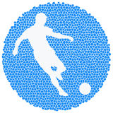 Silhouette of soccer player striking the ball Stock Photo