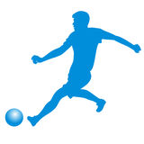 Silhouette of soccer player striking the ball Royalty Free Stock Photo