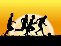 Silhouette of soccer player on sunset. Background Stock Photo