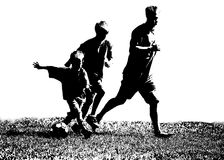 Silhouette Soccer Players. Black silhouette of two boys playing soccer with an adult Royalty Free Stock Photography