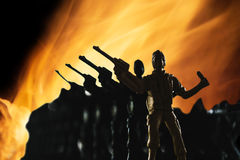 Silhouette of soilders in war Royalty Free Stock Photography