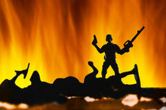 Silhouette of soilders in war Royalty Free Stock Image