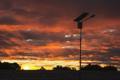 Silhouette Solar Power With the light color of the sky Stock Photo