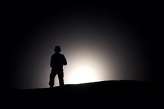 Silhouette Of A Soldier on a dark background stock image