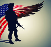 Silhouette of soldier in front of US flag. Silhouette of army soldier in front of stilyzed US flag in the form of huge wing. Pride and gratitude for years of Royalty Free Stock Photo