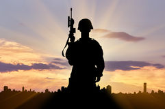 Silhouette of soldier with a gun Royalty Free Stock Photo