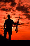 Silhouette of a soldier Stock Images