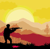Silhouette  of soldier holding gun Stock Photography