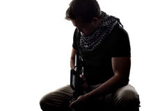Silhouette of a Soldier. Silhouette of a model as a homesick soldier or veteran suffering from PTSD Stock Images
