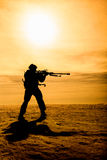 Silhouette of soldier with sniper rifle Stock Images