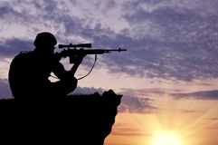 Silhouette of a soldier sniper Royalty Free Stock Photography