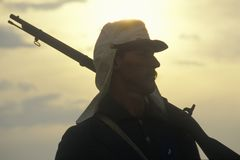 Silhouette of soldier at sunset with gun during reenactment of Battle of Manassas marking the beginning of the Civil War Stock Image