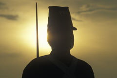 Silhouette of soldier at sunset with gun during reenactment of Battle of Manassas marking the beginning of the Civil War Stock Images