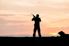 Silhouette of soldier on the top of mountain Stock Photo