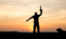 Silhouette of soldier on the top of mountain Stock Image