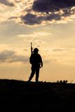 Silhouette of soldier. Silhouette of US soldier with rifle  against the sunset Royalty Free Stock Photos