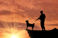 Silhouette of soldiers with weapons and dogs Stock Photos