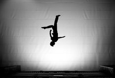 Silhouette somersault on trampoline Royalty Free Stock Photos