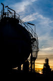 Silhouette of sphere gas storage tank Stock Photography