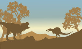 Silhouette of spinosaurus and T-Rex Stock Image