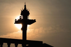Silhouette of spirit house in Thailand Stock Photography