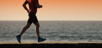 Silhouette of sport active man running Stock Photos